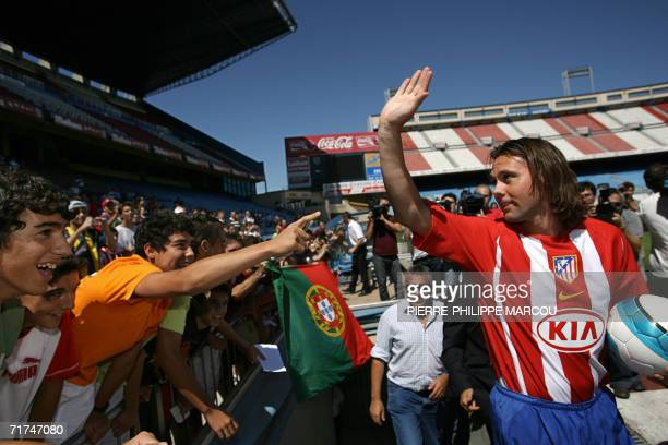 Atletico de Madrid's new signing Portuguese Maniche waves to fans on arrival at the Vicente Calderon stadium in Madrid 30 August 2006 AFP...