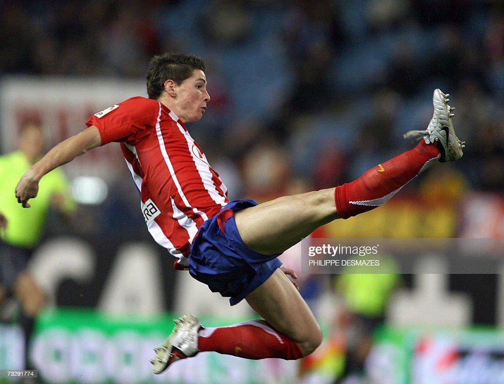 Atletico Madrid's Fernando Torres jumps... : News Photo