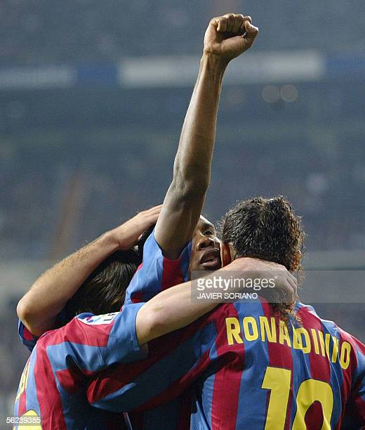 Barcelona's Cameroonian Samuel Eto'o celebrates with his teammates Brazilian Ronaldinho and Argentinian Leo Messi after scoring his first goal...