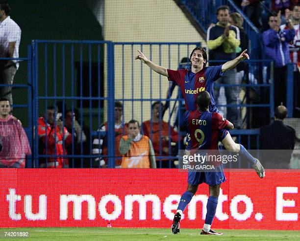 Barcelonas Messi and Ronaldinho jubilate after a fifth goal during a Spanish league football match against Atletico de Madrid 20 May 2007 at the...