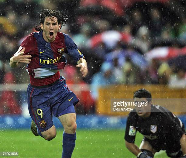 Barcelonas Messi celebrates after scoring their first goal during their Spanish league football match against Atletico de Madrid 20 May 2007 at the...
