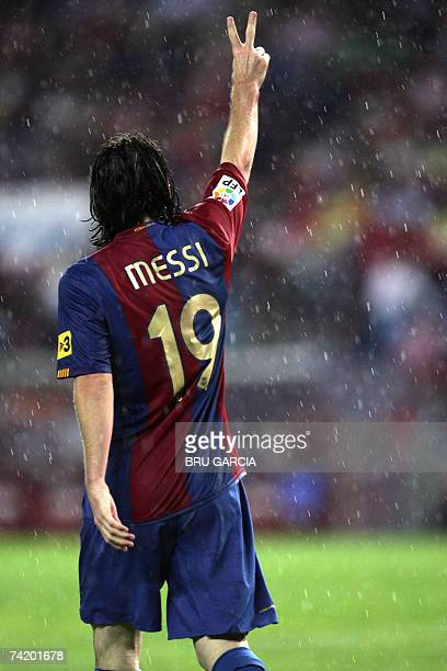 Barcelonas Messi gives the victory sign after scoring the first goal during a Spanish league football match against Atletico de Madrid 20 May 2007 at...