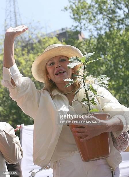 Baroness Thyssen Carmen Cervera waves during a rally in Madrid 05 May 2007 against the town hall's decision to uproot a group of centuriesold trees...