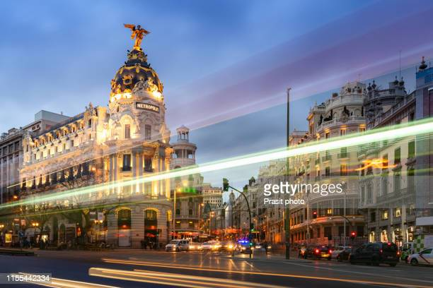madrid, spain cityscape on gran via at twilight. - gran via madrid fotografías e imágenes de stock
