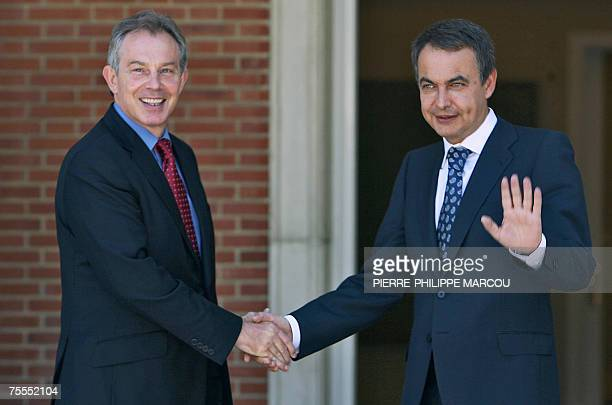 Former British Prime Minister and new envoy of the Middle East Quartet Tony Blair shakes hands with Spanish Prime Minister Jose Luis Rodriguez...