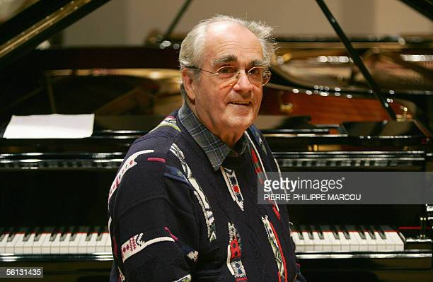 French pianist Michel Legrand poses during a rehearsal with Cuban pianist Chucho Valdes before their joint concert in Madrid 09 November 2005 AFP...