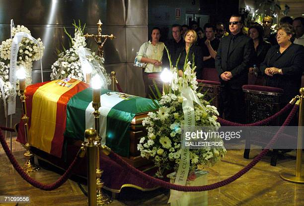 Jose Ortega Cano , the husband of Spanish singer Rocio Jurado stands by his sisters Conchi and Mari Carmen during the wake at a temporary funeral...