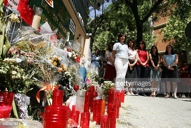 People observe two minutes of silence in memory of the victims of the 07 July London bombings in front of the British Embasy in Madrid 14 July 2005...