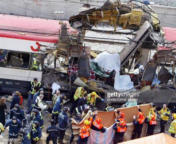 Photo taken 11 March 2004 of emergency services at the scene of the Madrid train bombing disaster The Spanish state prosecutor is calling for a...
