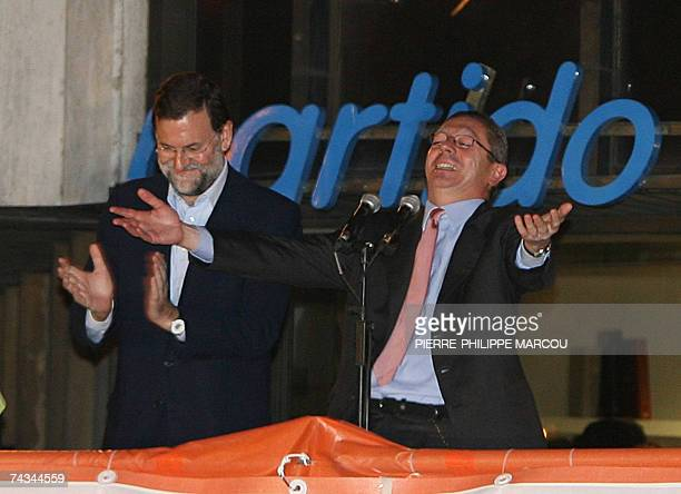 President of Popular Party Mariano Rajoy and Madrid's Mayor Alberto Ruiz Gallardon celebrate the results of the elections in Madrid 27 May 2006...