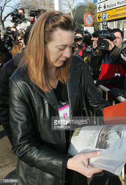 President of the association of victims of the Madrid train bombings Pilar Manjon reads a paper on arrival at the annex of the National Court in...