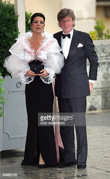 Princess Caroline of Monaco and her husband German Prince Ernst August of Hanover pose for photographers as they arrive to attend an official diner...