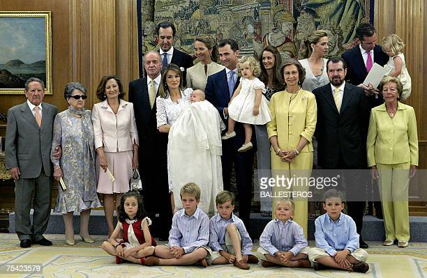 Princess Letizia and Prince Felipe pose with their two daughters Sofia and Leonor surrounded with Spanish royal family after the baptism ceremony of...