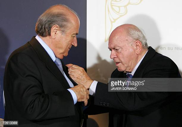 Real Madrid Honor President Alfredo Di Stefano awards Fifa President Joseph Blatter with a gold and diamonds badge during a tribute at the Santiago...