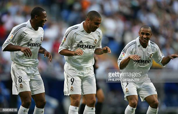 Real Madrid's Brazilian Ronaldo jubilates with his Brazilian teamates Julio Baptista and Roberto Carlos during their Spanish league football match...