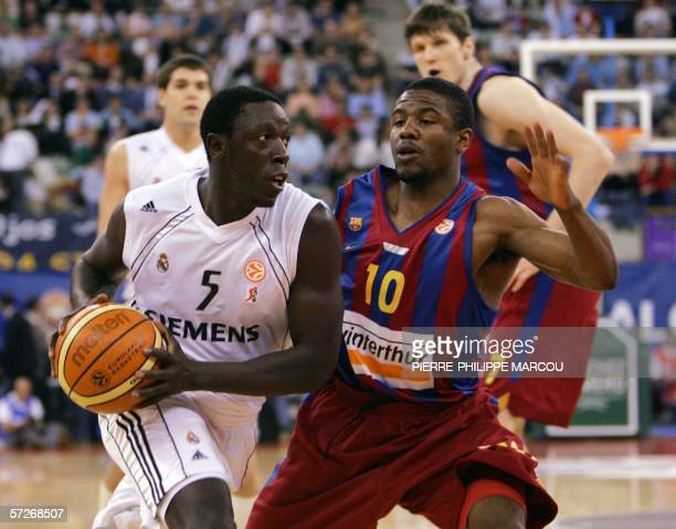 Real Madrid's Moustapha Sonko tries to pass Barcelona's Shammond Williams during their Euroleague quarterfinal second leg basketball match in Madrid...