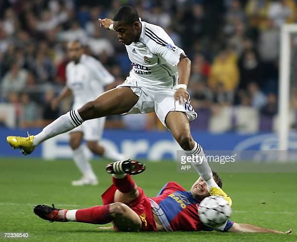 Real Madrid's Robinho is tackled by Steaua Bucharesi's Banel Nicolita during a Champions League Group E football match at the Santiago Bernabeu...