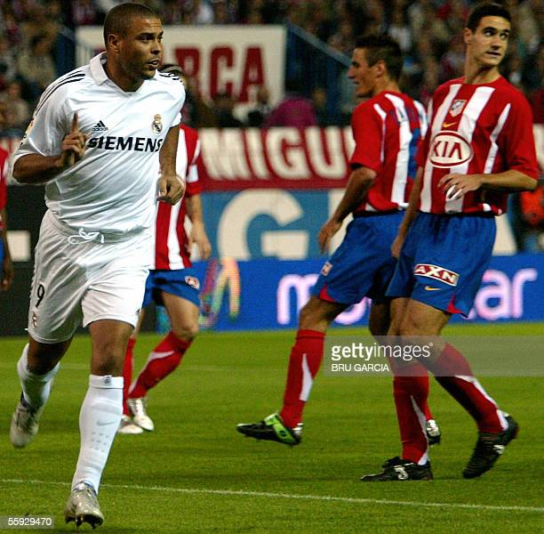 Real Madrid's Ronaldo celebrates after scoring from the penalty spot against Atletico de Madrid during their Spanish league football match at the...