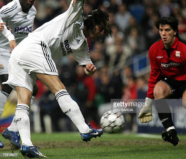 Real Madrid's Sergio Ramos vies for the ball with Olympique Lyonnais' goalkeeper Couppet during a Champions League Group E football match at Santiago...