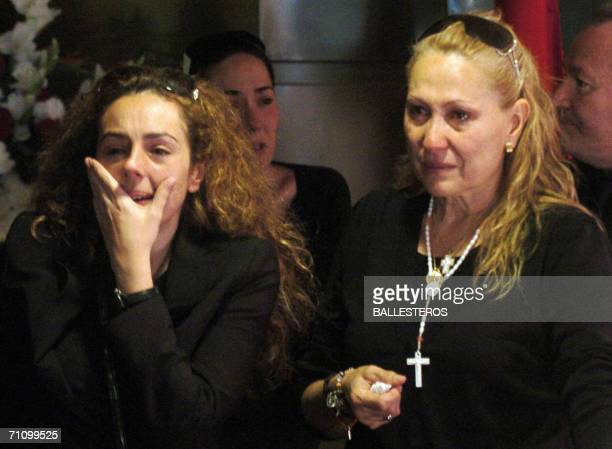 Rocio Carrasco the daughter of Spanish singer Rocio Jurado and Rosa Benito cry by her coffin in the temporary funeral chapel in the cultural centre...