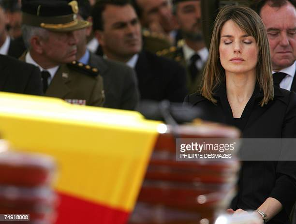 Spain's Princess Letizia closes her eyes during the funeral service of the 6 UN peacekeepers from the Spanish contingent including 3 Colombians who...