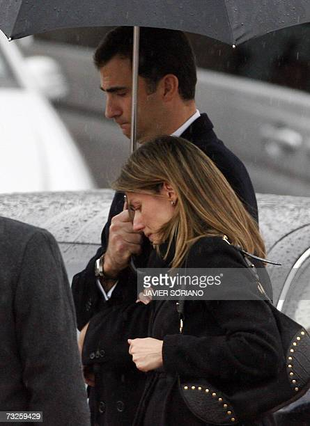 Spain's Princess Letizia is comforted by husband Prince Felipe as they depart from the crematorium of Tres Cantos after the funeral of her younger...