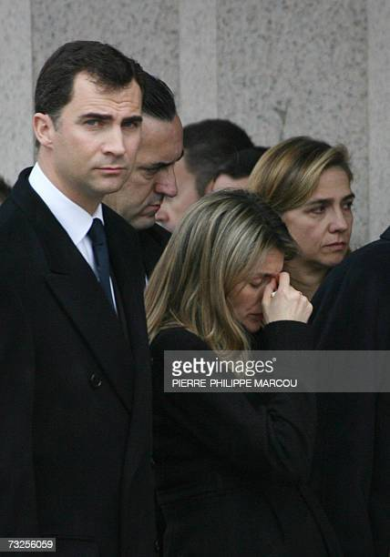 Spain's Princess Letizia leaves the funeral of her younger sister Erika Ortiz with husband Prince Felipe at the cemetery at Tres Cantos near Madrid...