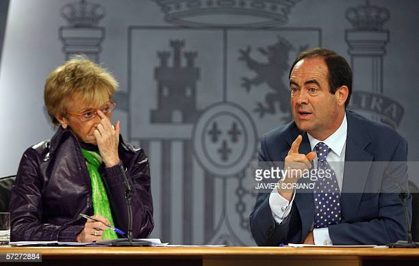 Spain's VicePrime Minister Maria Teresa Fernandez de la Vega and Defence Minister Jose Bono gesture during a press conference at Moncloa Palace in...