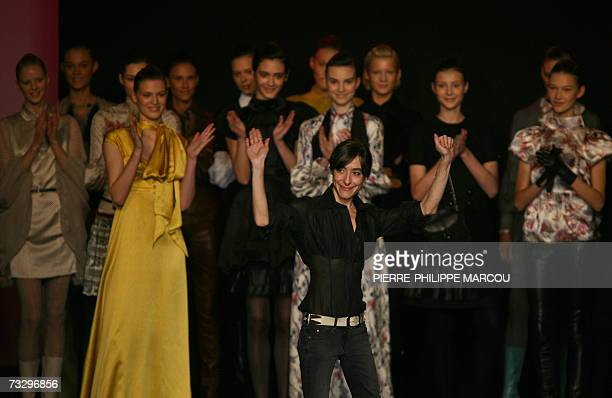Spanish designer Miriam Orcariz waves after presenting her Fall/Winter 2007 collection at Madrid fashion week 12 February 2007 AFP...