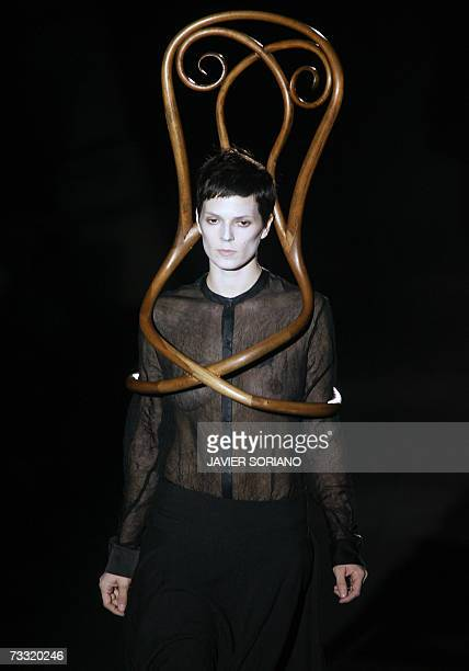 Spanish model Bimba Bose displays an outfit by Spanish designer David Delfin part of his Fall/Winter 2007 collection at Madrid fashion week 13...