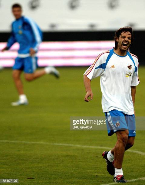 Spanish national football team player Fernando Morientes screams after injuring himself during a training session at the Vicente Calderon Stadium in...