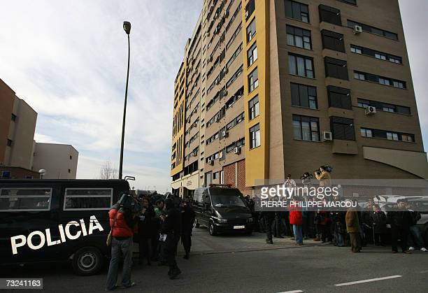 Spanish police hold back the press and passers as they wait for a hearse to pick up the body of Erika Ortiz younger sister of Spain's Princess...