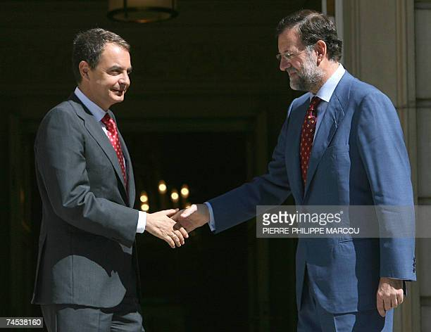 Spanish Prime Minister Jose Luis Rodriguez Zapatero shakes hand with Leader of Spanish opposition Popular Party Mariano Rajoy prior their meeting 11...
