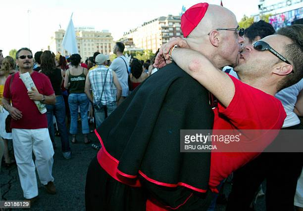 Two men one dressed as a priest kiss during the Gay Pride parade in Madrid 02 July 2005AFP PHOTO/ Bru GARCIA