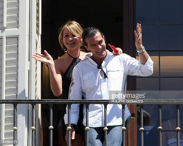 US actress Cameron Diaz and Spanish actor Antonio Banderas wave from a balcony during a photocall for Shrek 3 in Madrid 13 June 2007 AFP...