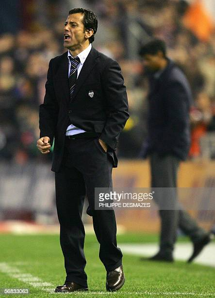Valencia coach Quique Flores and Barcelona coach Frank Rijkaard appear during their Spanish League match at Mestalla stadium of Valencia 12 february...