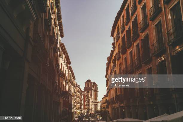 madrid street with church in the background - madrid stock pictures, royalty-free photos & images
