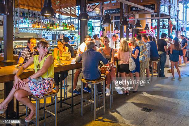 madrid tourists and locals at bar restaurants san miguel market - tapas stock photos and pictures
