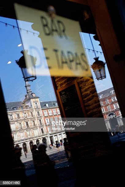 Madrid Town Hall Reflecting in Bar Window at Plaza Mayor