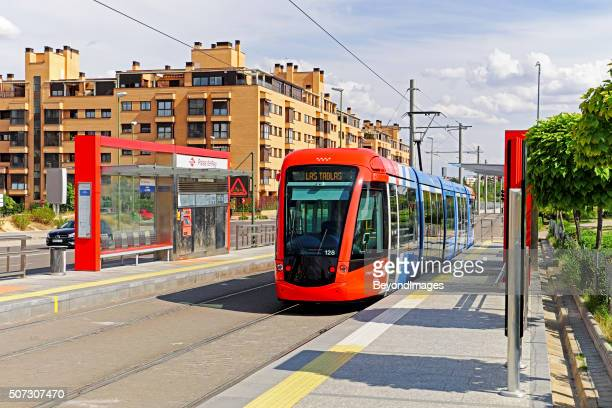 Madrid tram on Line ML-1 passes modern apartment building