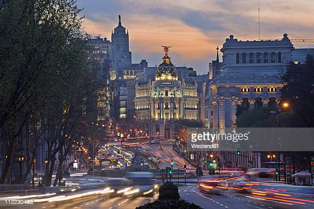 Madrid, View of Calle de Alcala and Plaza de Cibeles, Edificio Metropolis blurred traffic at dusk