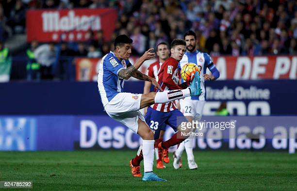 Atletico de Madrid's Argentinean forward Luciano Dar��o Vietto and Espanyols Chilean defender Enzo Roco during the Spanish League 2015/16 match...