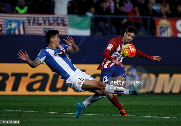 Atletico de Madrid's Argentinean forward Luciano Darío Vietto and Espanyols Chilean defender Enzo Roco during the Spanish League 2015/16 match...