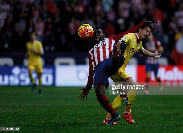 Atletico de Madrid's Colombian forward Jackson Martinez and Sporting Gijons Spanish Defender Luis H. During the Spanish League 2015/16 match between...