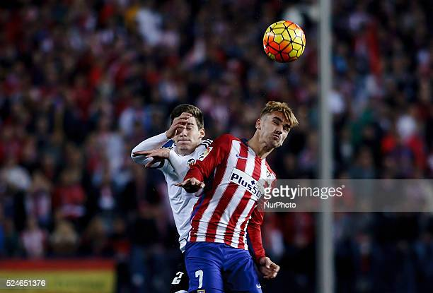 Atletico de Madrid's French forward Antoine Griezmann and Valencia's Spanish forward Santi Mina during the Spanish League 2015/16 match between...