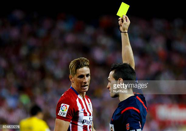 Atletico de Madrid's Spanish forward Fernando Torres receives a yellow card during the Spanish League 2015/16 match between Atletico de Madrid and UD...