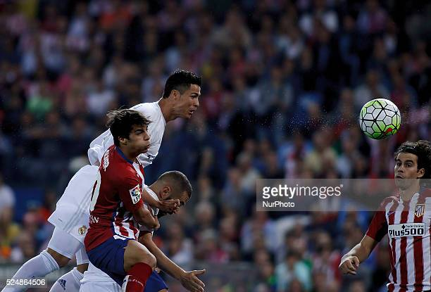 Atletico de Madrid's Spanish midfielder Oliver Torres and Real Madrid's Portuguese forward Cristiano Ronaldo during the Spanish League 2015/16 match...