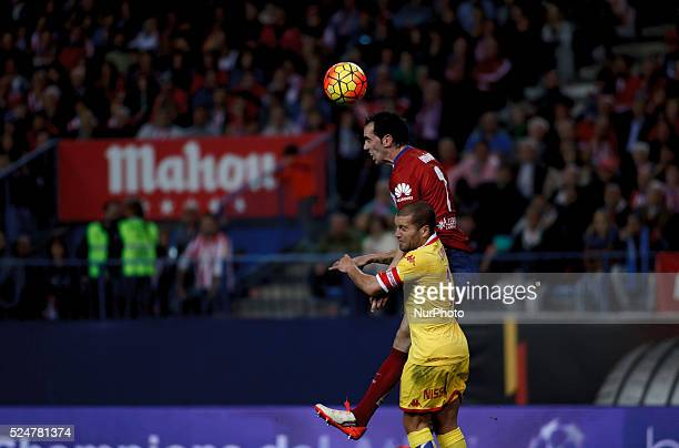 Atletico de Madrid's Uruguayan Defender Diego Godin and Sporting Gijons Spanish Defender Alberto Lora during the Spanish League 2015/16 match between...