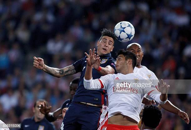 Atletico de Madrid's Uruguayan Defender Jose Maria Gimenez and Benfica's Brazilian Defender Luisao during the Champions League 2015/16 match between...