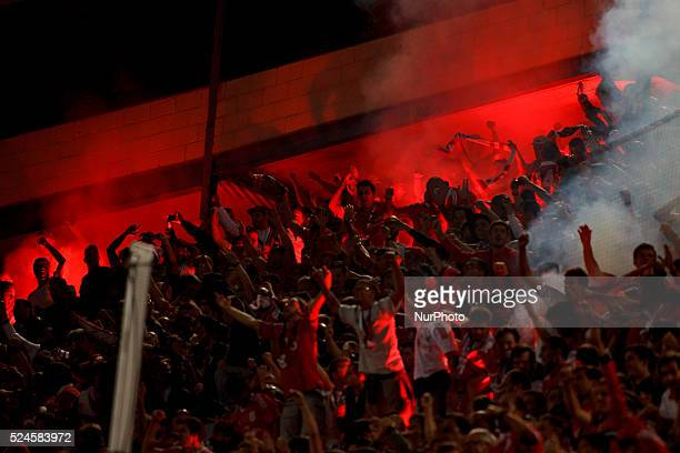 Fans of Benfica Celebrates a goal with flares during the Champions League 2015/16 match between Atletico de Madrid and Benfica at Vicente Calderon...